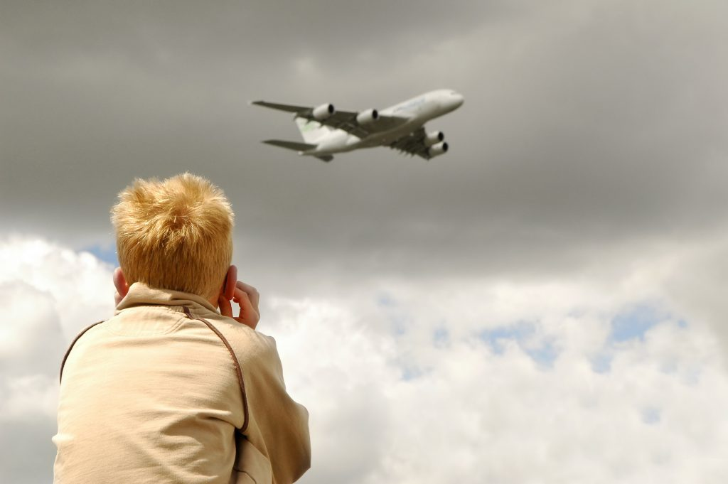 small child deafened by a low flying jet